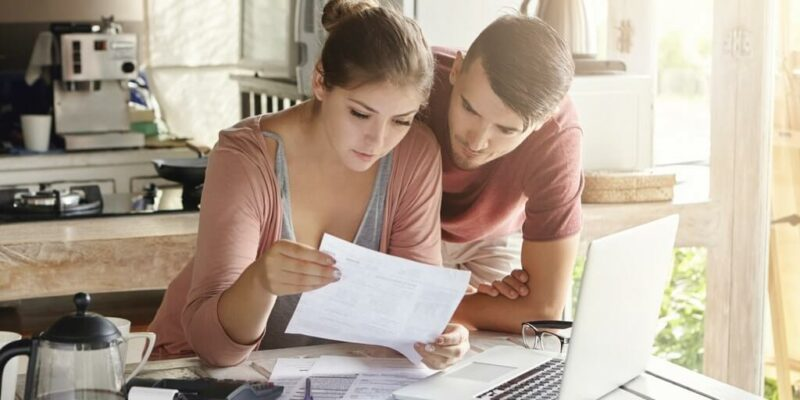 Couple making buying a new house checklist