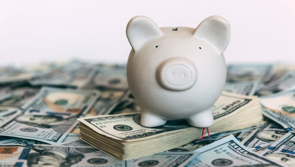 Piggy moneybox with money saved from Hero Home Programs