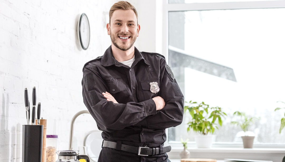 Police officer happy after getting approved on his home loan.