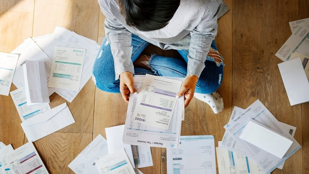 Woman sorting bank statements