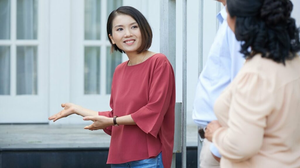 Young lady showing house to relatives.